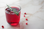 Glass of tasty pomegranate juice on table