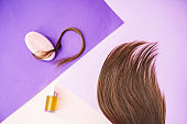 Composition with cosmetics against hair loss on color background