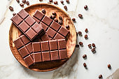 Plate with sweet tasty chocolate on table