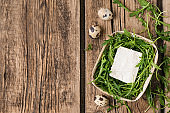 Tray with tasty feta cheese and arugula on wooden table