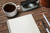 Stationery with cup of coffee on wooden table. Concept of business planning