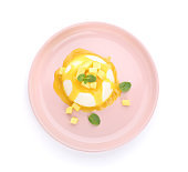 Plate with tasty panna cotta on white background