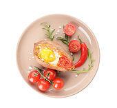 Baked sweet potato with egg and tomato on white background