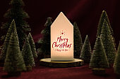 Merry christmas and happy new year text on home lamp with xmas tree on red velvet fabric table in dark night mood