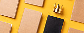 content is king for online marketing concept.top view of notebook with golden crown align with kraft paper book in pattern on yellow table background