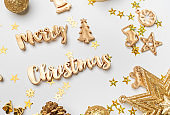 merry Christmas gold  shiny text with luxury xmas decoration items on white table.happy new year holiday concept