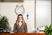 Receptionist woman is protected from coronavirus