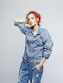 Fashion portrait of young woman in 80's style outfit