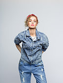 Confident young woman in 80's style outfit
