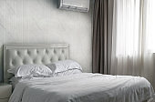 hotel bedroom interior decorate with double bed and white marble wall and curtain flair.