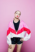 Fashion portrait of beautiful woman in 80'stle sport clothing