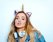Displeased young woman with unicorn horn headband