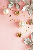 Christmas background . Xmas or new year decorations on pink background with empty copy space for text. holiday concept for postcard or invitation. top view.