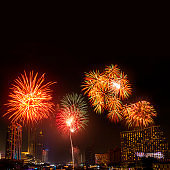 Beautiful firework display for celebration happy new year and merry christmas with  Twilight night and firework lighting in bangkok cityscape background, Thailand.