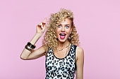 Surprised young woman in 80's style outfit staring at camera