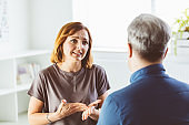 Worried woman talking with psychotherapist