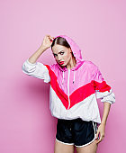 Fashion portrait of beautiful woman in hoodie tracksuit