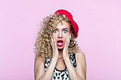 Surprised woman in 80's style clothes