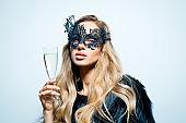 Studio portrait of elegant woman with carnival mask stock photo
