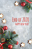 End of 2020 Happy New Year text. Flat lay on grey background. Zero Waste Christmas decor. cookies