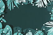 Tidewater green color background. Trendy flat lay, top view with decorative paper exotic leaves