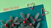 Christmas two tone green background. Text Merry Christmas. Top view, panoramic composition
