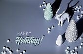 Isometric Christmas arrangement with deer and Xmas trees in black white monochrome. Trendy two tone paper background, text Happy Holidays