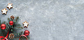 Flat lay on grey board, panoramic, copy-space. Low impact living, natural Christmas decorations