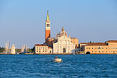 Boat taking people from the island of San Giorgio Maggiore towards Venice