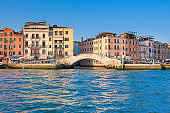 Romantic Venice. Traditional houses and pedestrian bridge in Venice, Italy
