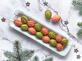 Walnut shaped Cookies with Dulce De Leche on marble table with winter decorations