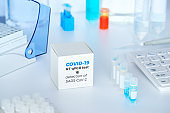 Quick novel COVID-19 coronavirus test kit. 2019 nCoV pcr diagnostics kit. Hand in glove with the box. The kit detects covid19 virus. Тest system for real-time quantitative PCR amplification.