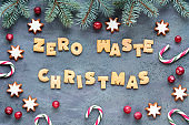 Text Zero Waste Christmas made with cookies. Xmas background, low impact biodegradable decorations