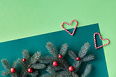 Christmas two tone green background with text space. Top panoramic view, on fir twigs with toys