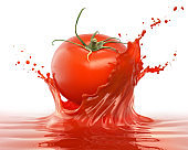 red tomato falling with liquid juice or Ketchup splash.
