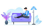 The man is sitting on the couch and holding a laptop. Freelance and learning at home. Room interior in cold shades. Vector illustration