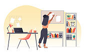 A young woman with dark hair attaches a document to board. Work from home. Workplace interior. Vector flat illustration.