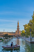 Plaza de Espana Square with Boats on the Canal in Beautiful Seville Spain vertical