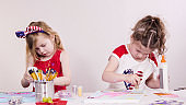 Little girls dress in patriotic red, white, and blue clothes creating