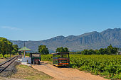 A Excursion Car waiting for Guest to bring them to a Wine Tasting Tour at Rickety Bridge Winery Railway Station, Franschhoek