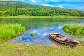 Idyllic green scenery with wooden boat