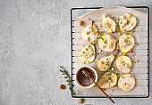 Baked pears with blue cheese,walnuts, honey and herbs. French cuisine Appetizer to wine.