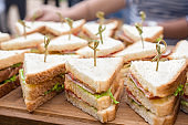 Kosher catering background. Food catering. Slider bar background. Vegan sliders, ham and vegetable slider bar. Buffet food for party catering. Cuisine Culinary Gourmet Buffet. Sandwich tray