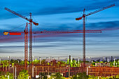 Cranes at sunset. Building under construction. Construction machinery