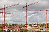 Red cranes. Building under construction. Cranes construction machinery