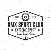 Bmx extreme sport club badge. Vector. Concept for shirt, logo, print, stamp, tee with frames, chain. Vintage typography design with bmx frames, sprocket silhouette.