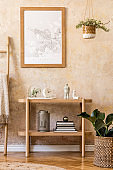 Stylish scandinavian interior of living room with mock up poster frame, wooden console, plants, ladder, decoration, grunge wall and elegant personal accessories in modern home decor.