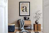Modern scandinavian living room interior with black mock up poster frame, design commode, dried flower in vase, black rattan basket, books and elegant accessories. Template.