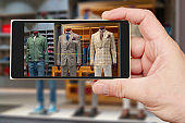 Male mannequin on smartphone screen.