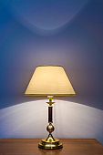 Table lamp near wall